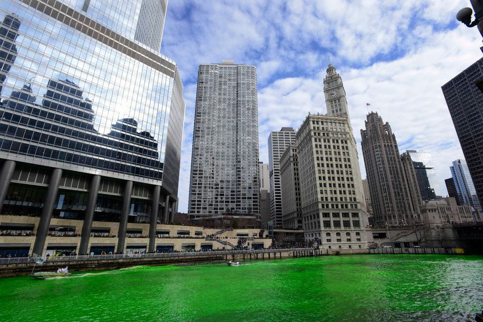 Dye colors the Chicago River green ahead of the St. Patrick's Day parade in Chicago on Saturday, March 15, 2014. (AP Photo/Pa