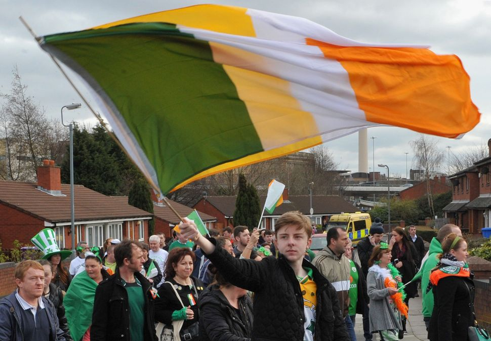 Marchers walk through the streets during the St Patrick's Day Parade on March 17, 2014 in Liverpool, England. (Richard Martin