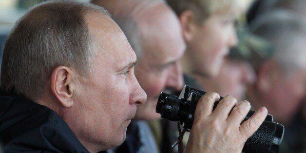 GRODNO, BELARUS - SEPTEMBER 26:  Russian President Vladimir Putin (C) and Belarussian President Alexander Lukashenko (R) watc