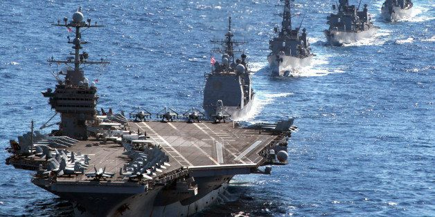 US aircraft carrier USS George Washington leads a US guided missile cruiser and three Japanese destroyers during the Keen Swo