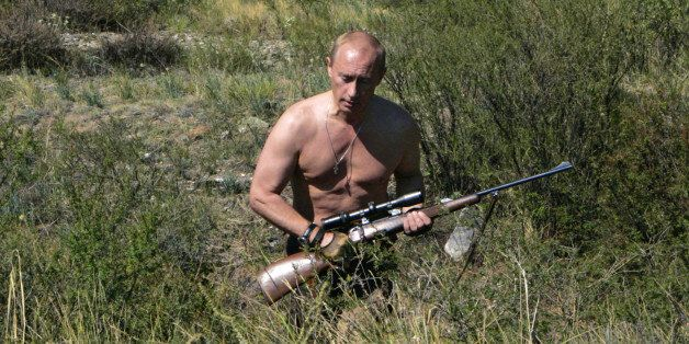 This pool picture provided 03 September 2007 shows Russian President Vladimir Putin carrying a hunting rifle in the Republic