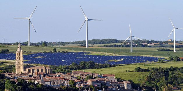 Wind turbines and a solar park are pictured on May 26, 2013 near the village of Avignonet-Lauragais, located southeast of Tou