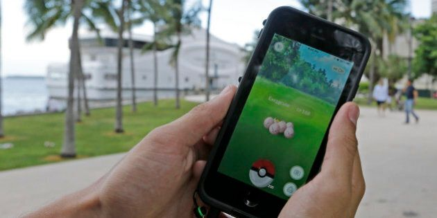 Exeggcute, a Pokemon, is found by a Pokemon Go player, Tuesday, July 12, 2016, at Bayfront Park in downtown...