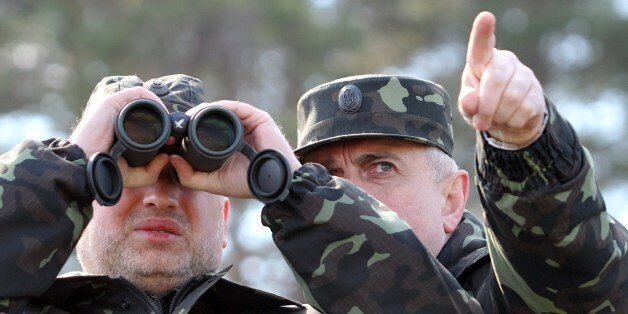 Acting Minister of Defence of Ukraine Michail Koval (R) and Olexander Turchynov, speaker of the parliament and the interim pr