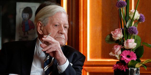 Former German Chancellor Helmut Schmidt smokes a cigarette during a meeting with Prime Minister of China, Li Keqiang (not in