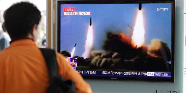 SEOUL, SOUTH KOREA - MARCH 26:  A Man watchs a television broadcast reporting the North Korean missile launch at the Seoul Ra