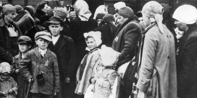 Auschwitz, poland, world war 2, concentration camp victims after disembarking from a freight train at the station near the ca