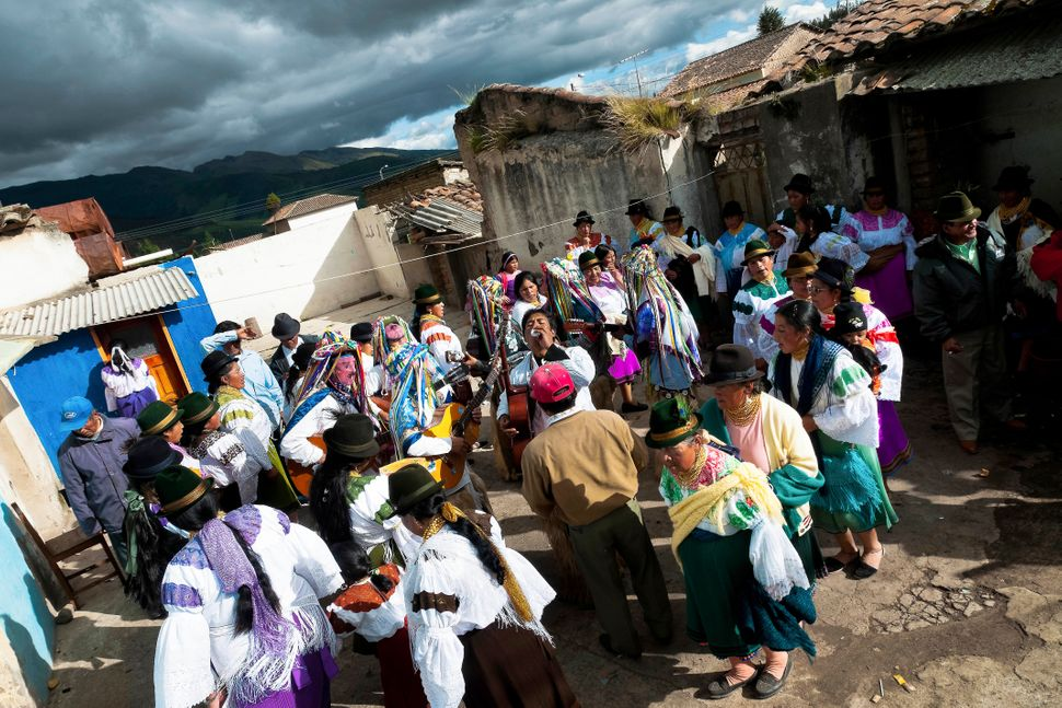 Indians, wearing colorful costumes, dance in the circle during the Inti Raymi festival on 26 June 2010 in the village of Olme