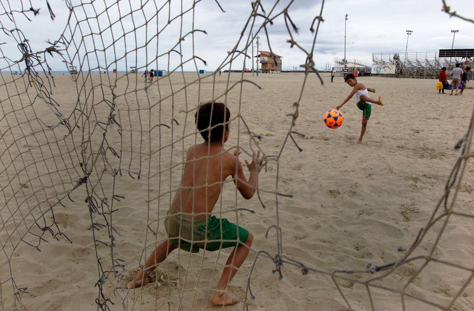 Boys play soccer on the beach in Manta, Ecuador, Saturday, June 29, 2013. (Martin Mejia/AP)