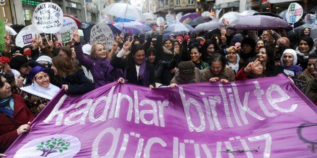 Turkish women hold a banner reading 'Women, we are strong together' during a march at Istiklal avenue in Istanbul, as part of