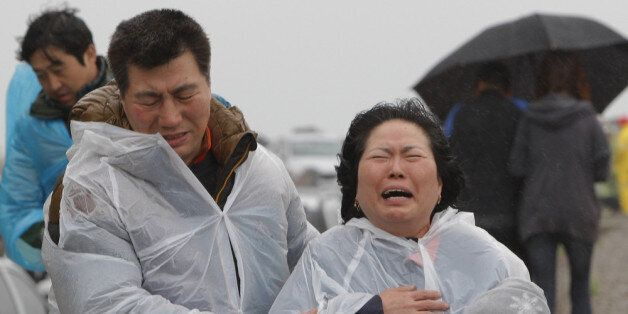 JINDO-GUN, SOUTH KOREA - APRIL 17:  A relative weeps as she waits for missing passengers of a sunken ferry at Jindo gymnasium