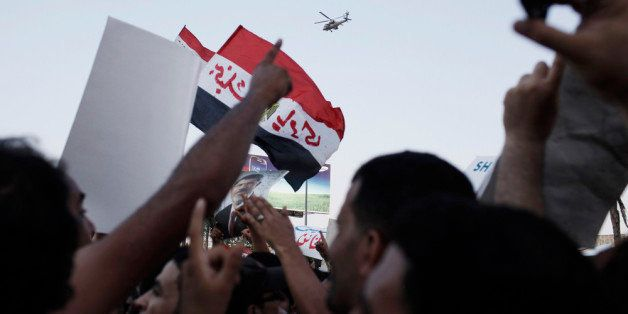 CAIRO, EGYPT - JULY 5:  Supporters of former Egyptian President Mohammed Morsi demonstrate in front of the headquarters of th