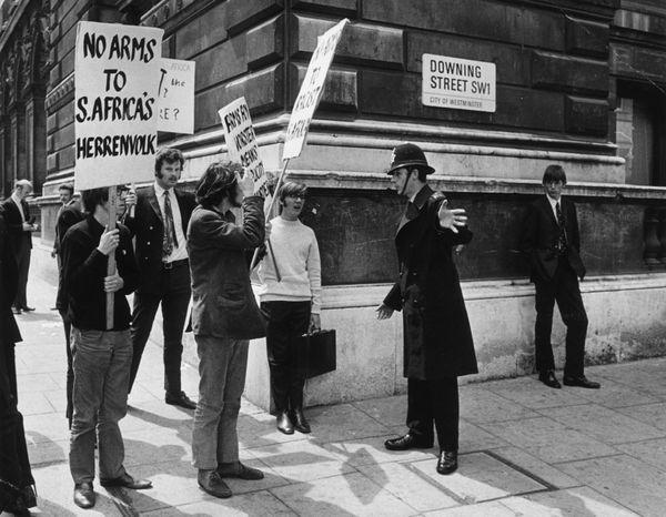 "Renewed <a href=""http://www.history.com/topics/apartheid"" target=""_blank"">international pressure</a> places further strain on"