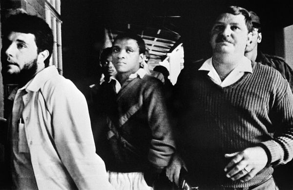 """In 1985, South Africa's government attempts a nationwide crackdown on the growing revolution, <a href=""""http://overcomingapart"""