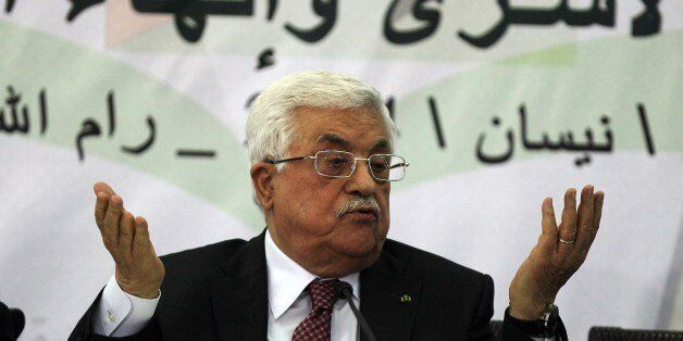 Palestinian Authority President Mahmud Abbas gestures as he gives a speech during a meeting with the Palestine Liberation Org