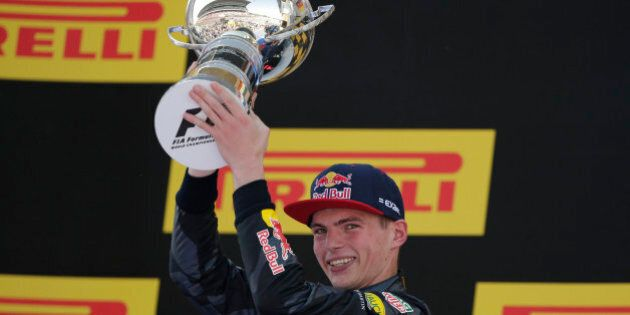Red Bull driver Max Verstappen of the Netherlands lifts the trophy after winning the Spanish Formula...