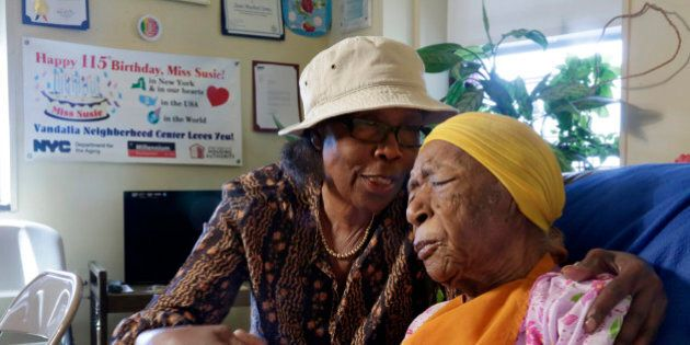 In this Monday, June 22, 2015 photo, Susannah Mushatt Jones, 115, right, is embraced by her niece Lois...
