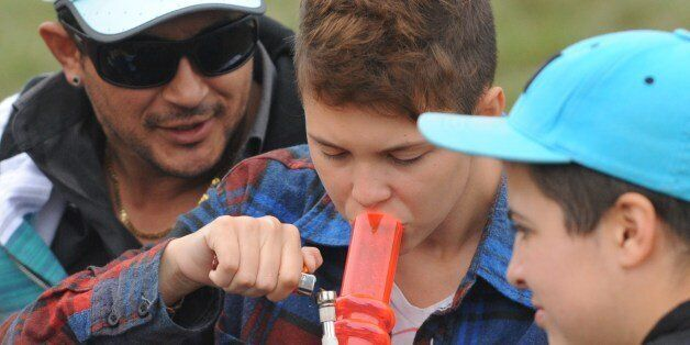 A youngster smokes marijuana during the World Day for the Legalization of Marijuana on May 3, 2014 in Montevideo. Uruguay Fri