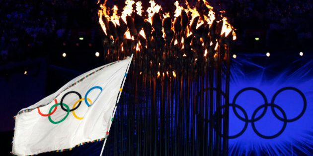 President of the International Olympic Committee Jacques Rogge, left, hands the Olympic flag to Rio de...