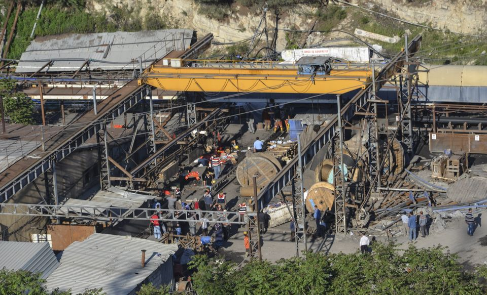 People gather at a mine in the Soma district in the western Turkish province of Manisa on May 13, 2014, after it collapsed du