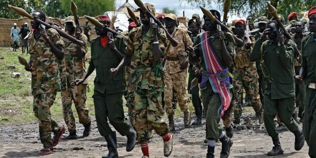 Members of the South Sudan Democratic Movement/Army (SSDM/A) faction march in Gumuruk on May 13, 2014. The faction's leader,