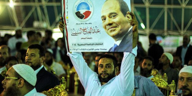 CAIRO, EGYPT - MAY 20:  An Egyptian holds poster of president candidate Abdel Fattah el-Sisi during Younis Makhyoun (not seen