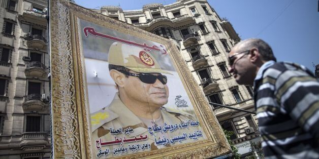 A poster of Egyptian ex-army chief and leading presidential candidate Abdel Fattah al-Sisi stand near a building in central C