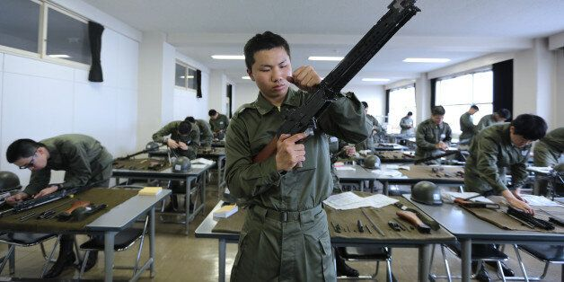 National Defense Academy of Japan (NDA) cadets dismantle and reassemble rifles during a class at the NDA campus in Yokosuka,