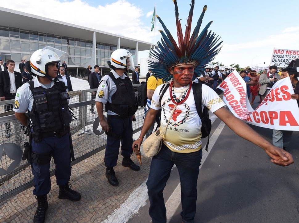 Indigenous Brazilians protest in front of the Planalto palace, the official workplace of Brazil's Presidency in Brasilia on M