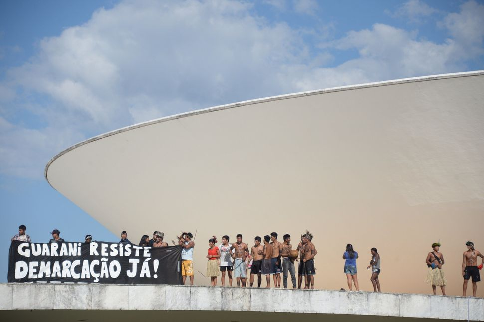 Indigenous Brazilians protest  on top of the National Congress in Brasilia on May 27, 2014. (EVARISTO SA/AFP/Getty Images)