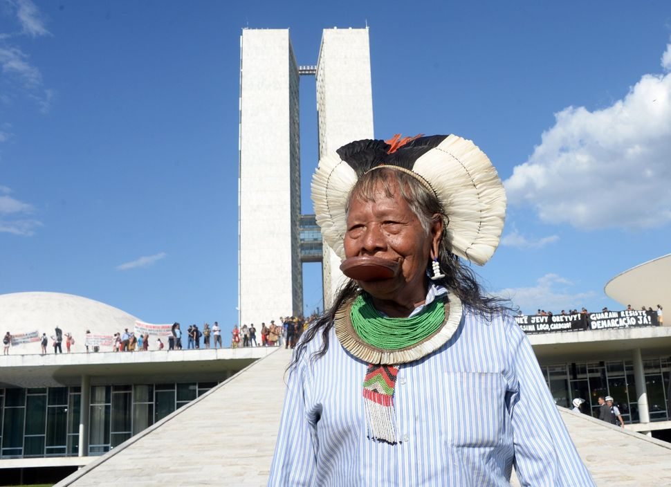 Brazilian chief Raoni attends a protest in front of the National Congress in Brasilia on May 27, 2014. (EVARISTO SA/AFP/Getty