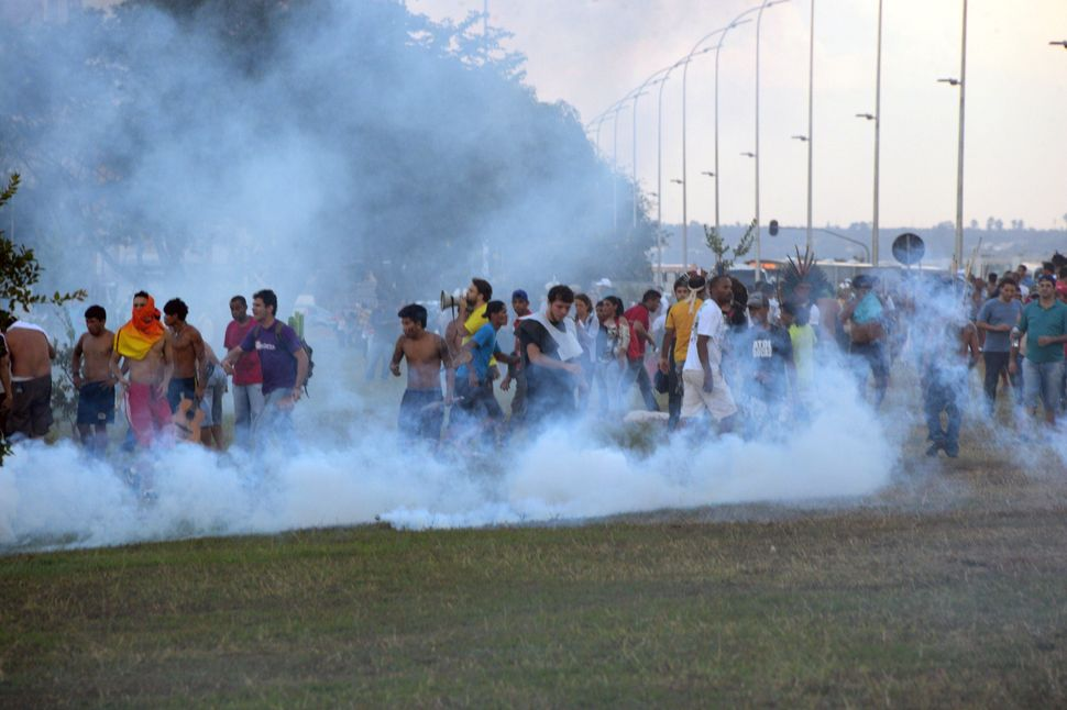 People protest against the upcoming World Cup in Brasilia on May 27, 2014. (EVARISTO SA/AFP/Getty Images)