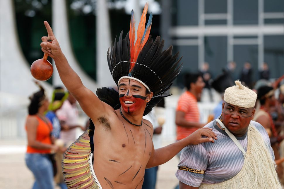 Indigenous Brazilians protest outside the Supreme Court in Brasilia, Brazil, May 27, 2014. (AP Photo/Eraldo Peres)
