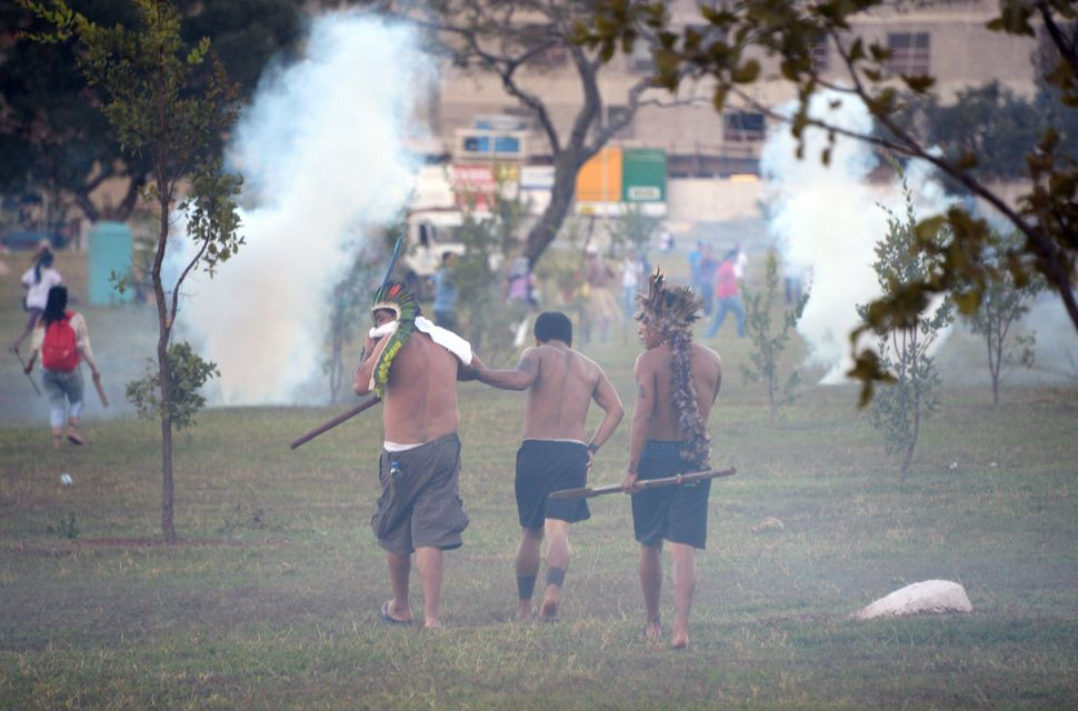 Indigenous people protest in Brasilia on May 27, 2014. (EVARISTO SA/AFP/Getty Images)