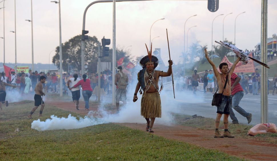 An indigenous man protests in Brasilia on May 27, 2014. (EVARISTO SA/AFP/Getty Images)