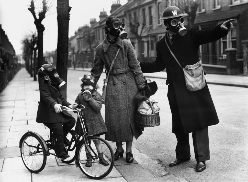 A warden gives directions to a mother and her two children during a World War II gas drill in Southend on Marcy 29, 1941. (Er