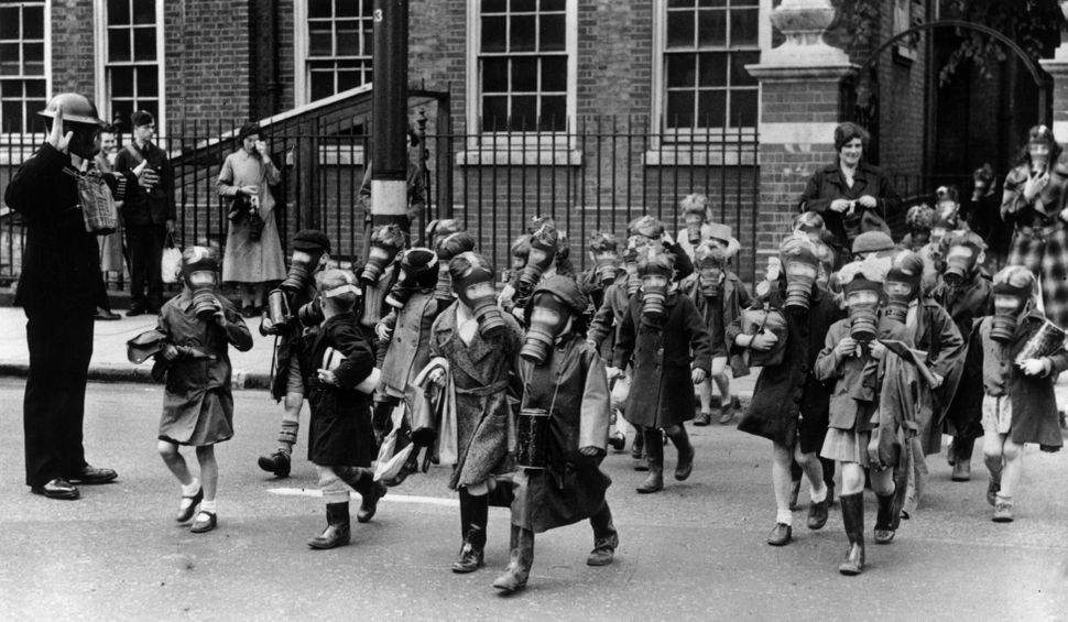 A horde of children wearing gas masks carry out a practice evacuation of a school in Kingston, Greater London, after a canist
