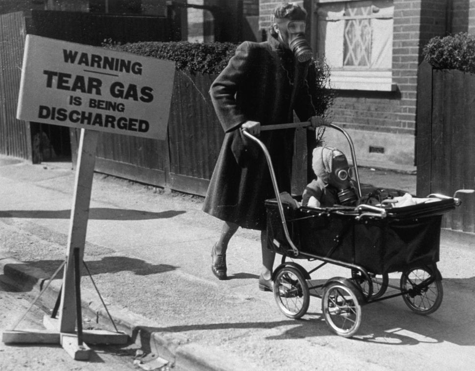A gas exercise for civilians, using tear gas, was held in Kingston-On-Thames in 1941.  (Keystone/Getty Images)