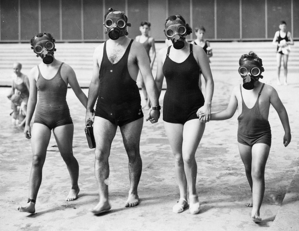 A family use respirators at the Empire Pool, Wembley, London on August 21, 1938.  (Fox Photos/Getty Images)