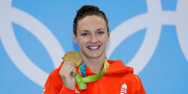 Hungary's Katinka Hosszu shows off her gold medal during the ceremony for the women's 400-meter individual...