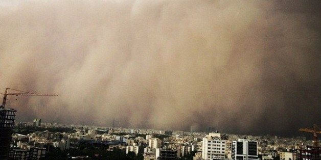 A picture taken with a smart-phone shows a sandstorm engulfing the Iranian capital Tehran on June 02, 2014. A massive sandsto