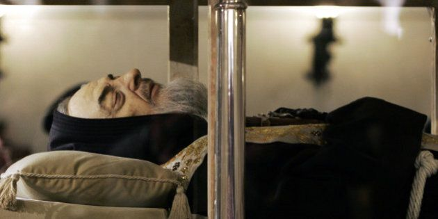 A silicon hand-painted bearded mask of the face of Padre Pio, an Italian saint, is seen on his body laying...