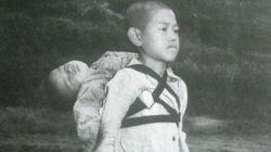 La storia della foto del bambino di Nagasaki e del fratellino morto sulle