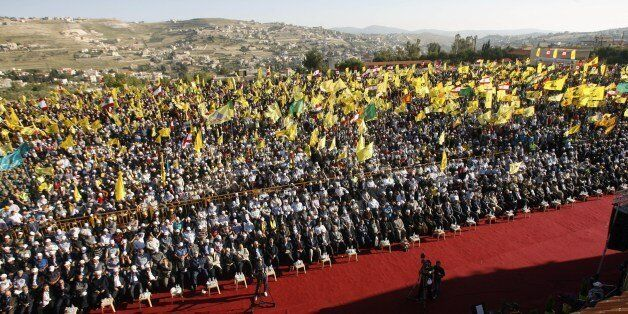 Lebanese supporters of Shiite Hezbollah movement gather in the southern town of Bint Jbeil, to watch a televised address by H