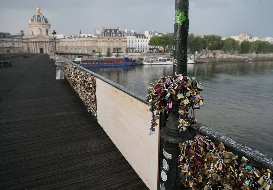 A photo taken on June 9, 2014 shows 'love padlocks' attached to a fence of the Pont des Arts bridge over the Seine river in P