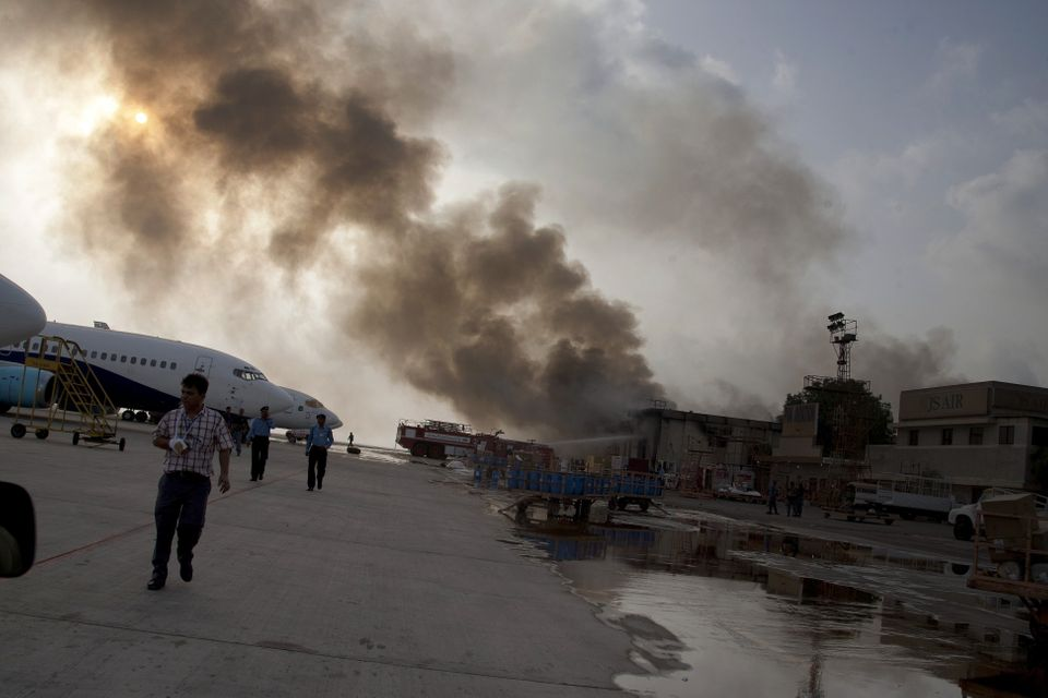 Smoke rises above the Jinnah International Airport where security forces battled militants Monday, June 9, 2014, in Karachi,