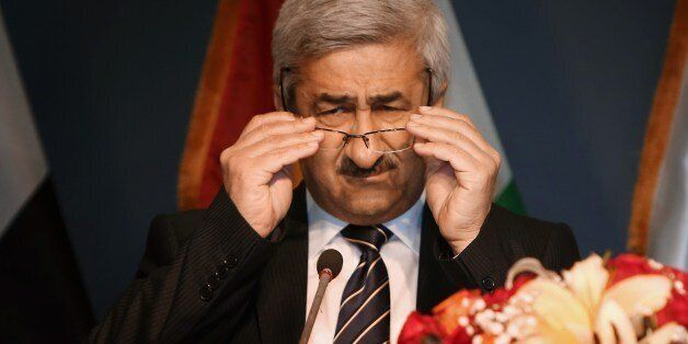 Sarbast Mustafa (C), Chairman of the Independent High Electoral Commission, adjusts his glasses as he speaks to the press to