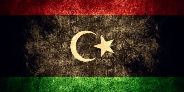 flag of Libya or Libyan banner on rough pattern texture vintage