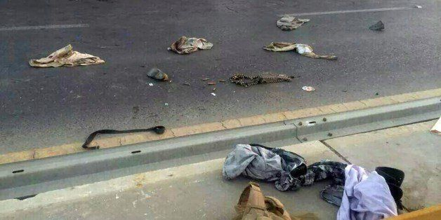 A picture taken with a mobile phone shows uniforms reportedly belonging to Iraqi security forces scattered on the road on Jun