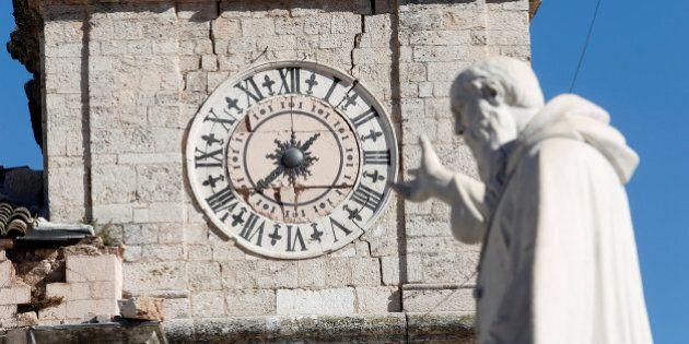 The clock of the damaged town hall tower is seen in the ancient city of Norcia following an earthquake...